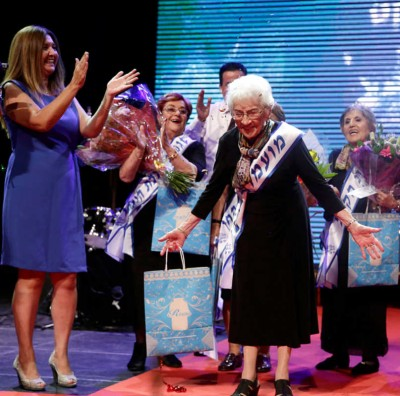 HAIFA, ISRAEL - OCTOBER 14:  Holocaust survivor Tova Ringer (C) ,93, celebrates after winning the  annual Holocaust Survivor Beauty Pageant on October 14, 2018 in Haifa, Israel. The pageant was started in 2012 for women who survived the Holocaust. (Photo by Amir Levy/Getty Images)